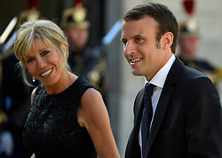 French Minister of Economy, Recovery of Productivity and Digital Affairs Emmanuel Macron and wife Brigitte Trogneux arriving at the Elysee Palace for a state dinner in honor of King Felipe VI and Queen Letizia of Spain, in Paris, France on June 2, 2015. The Spanish royal couple, who cut short their March 2015 state visit to France after a Germanwings Airbus crashed in the French Alps killing 45 Spanish citizens, are on a three-day official state visit to France. Photo by Christian Liewig/ABACAPRESS.COM  | 503088_087 Paris TraductionPae France