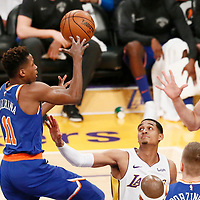 21 January 2018: New York Knicks guard Frank Ntilikina (11) goes for the pass to New York Knicks center Enes Kanter (00) during the LA Lakers 127-107 victory over the New York Knicks, at the Staples Center, Los Angeles, California, USA.