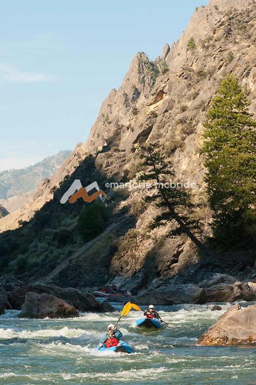 Kayaing in morning light in The Impassible Canyon on the Middle Fork of the Salmon River during six day rafting vacation, Idaho.