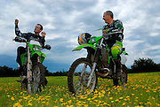 Bill Dragoo (model released) and Brad Black (model released) on 2006 Kawasaki KLX-250S and 2005 Kawasaki KDX-200 at Crossbar Ranch ORV area in Davis, Oklahoma.