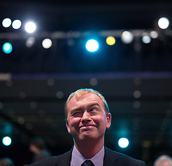 © Licensed to London News Pictures . 07/10/2014 . Glasgow , UK . TIM FARRON , President of the Liberal Democrats and MP for Westmorland and Lonsdale , sits and winks as the audience applaud his speech to the conference . The Liberal Democrat Party Conference 2014 at the Scottish Exhibition and Conference Centre in Glasgow . Photo credit : Joel Goodman/LNP