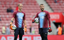 """Burnley goalkeepers Joe Hart (left) and Adam Legzdins before the Premier League match at St Mary's, Southampton. PRESS ASSOCIATION Photo. Picture date: Sunday August 12, 2018. See PA story SOCCER Southampton. Photo credit should read: Andrew Matthews/PA Wire. RESTRICTIONS: EDITORIAL USE ONLY No use with unauthorised audio, video, data, fixture lists, club/league logos or """"live"""" services. Online in-match use limited to 120 images, no video emulation. No use in betting, games or single club/league/player publications."""