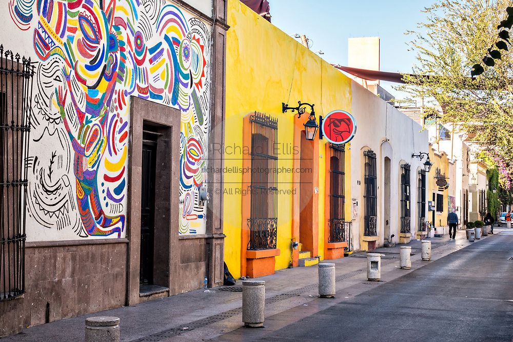 Colorful Spanish Colonial style buildings and cobblestone streets in the Barrio Antiguo or Spanish Quarter neighborhood adjacent to the Macroplaza Grand Plaza in Monterrey, Nuevo Leon, Mexico.