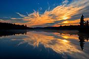 Sunrise reflection on Lac du fou<br />La Mauricie National Park<br />Quebec<br />Canada