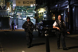 © Licensed to London News Pictures. 03/06/2017. London, UK. Armed police guard Borough Market after a terrorist incident involving a vehicle and pedestrians in London Bridge.  Reports are saying a white transit van may have deliberately run down people crossing the bridge. Photo credit: Tolga Akmen/LNP