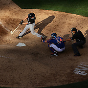 Catcher Rob Brantly, Miami Marlins, hits a pitch in the late afternoon sunlight during the New York Mets V Miami Marlins, Major League Baseball game which went for 20 innings and lasted 6 hours and 25 minutes. The Marlins won the match 2-1. Citi Field, Queens, New York. 8th June 2013. Photo Tim Clayton