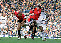 Mikael Silvestre and Ruud Van Nistelrooy combine to challenge Zoumana Camara (Leeds). Leeds United v Manchester United. 18/10/03. Credit : Colorsport/Andrew Cowie.