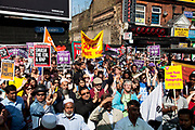 Anti fascist demonstration in Whitechapel, Tower Hamlets, East London. This gathering was very peaceful and very mixed in terms of race, as local people stood together against proposed demonstration by the EDL. The national demo against the English Defence League organised by Unite Against Fascism in Tower Hamlets was held on the corner of Vallance Road and Whitechapel Road.
