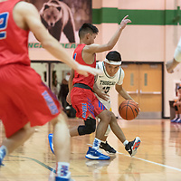Thoreau's Orin Chacho (13) dribbles down the court as Hot Springs' Aljon Pinili (11) at the Wingate Holiday Classic basketball tournament at Wingate High School Friday evening.