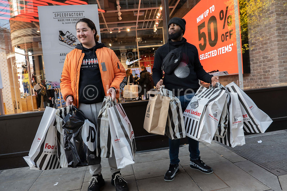 Shoppers outside Foot Locker store on London's Oxford Street for the Black Friday event on the 29th November 2019 in central London in the United Kingdom. Black Friday is a shopping event that originated from the US where retailers cut prices on the day after the Thanksgiving holiday.