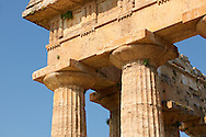 Close up of the ancient Doric Greek capitals & columns of the  Temple of Hera of Paestum built in about 460-450 BC. Paestrum archaeological site, Italy. .<br /> <br /> If you prefer to buy from our ALAMY PHOTO LIBRARY  Collection visit : https://www.alamy.com/portfolio/paul-williams-funkystock/paestum-greek-temples.html<br /> Visit our CLASSICAL WORLD HISTORIC SITES PHOTO COLLECTIONS for more photos to buy as buy as wall art prints https://funkystock.photoshelter.com/gallery-collection/Classical-Era-Historic-Sites-Archaeological-Sites-Pictures-Images/C0000g4bSGiDL9rw