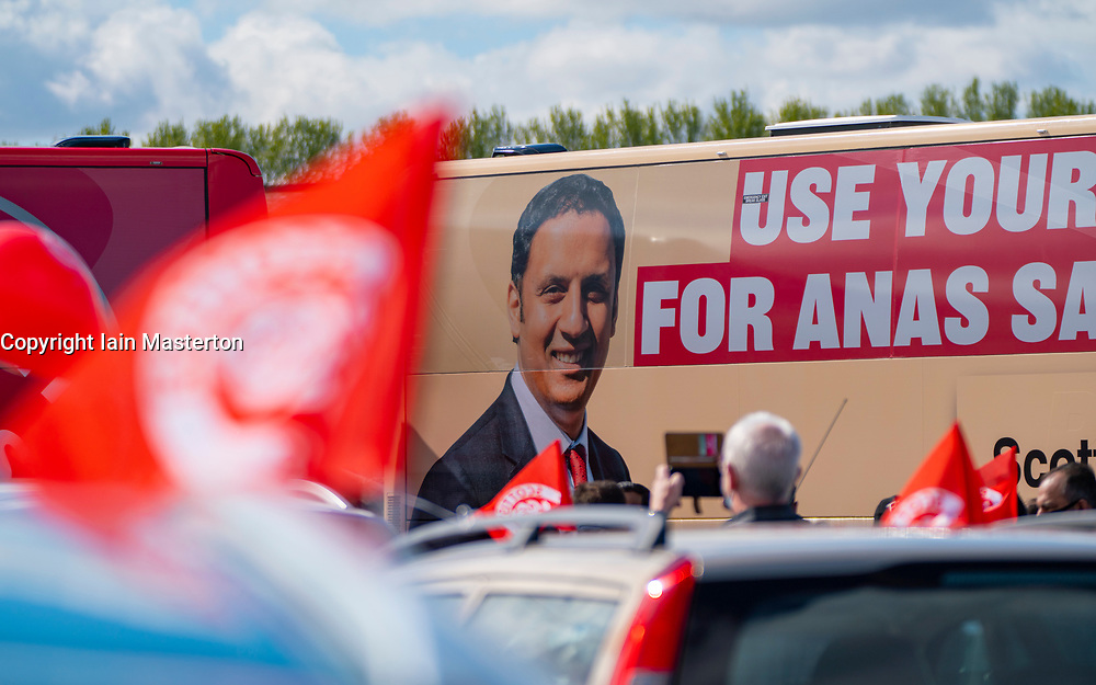 Glasgow, Scotland, UK. 5 May 2021. Scottish Labour Leader Anas Sarwar and former Prime Minister Gordon Brown appear at an eve of polls drive-in campaign rally in Glasgow today. Anas Sarwar image on Labour campaign bus.  Iain Masterton/Alamy Live News