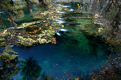 Stock photo of water flowing over natural rock formations in the river in the Texas Hill Country