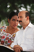 Mexican President Carlos Salinas de Gortari listens to a woman in traditional dress while waiting to speak during a Presidential trip to the Yucatan, Mexico.