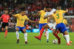 14 November 2017 -  International Friendly - England v Brazil - Marcus Rashford of England in action with Miranda and Marquinhos of Brazil - Photo: Marc Atkins/Offside