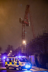 © Licensed to London News Pictures. 10/12/2019. London, UK. Police and security inspect a huge construction crane which collapsed in Fassett Road off Penrhyn Road, Kingston next to the University as high winds and rain hit the London area. Weather experts have predicted that wind, rain and showers will continue for the General Election on Thursday 12th December 2019. Photo credit: Alex Lentati/LNP