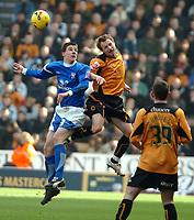 Photo: Ed Godden.<br />Wolverhampton Wanderers v Ipswich Town. Coca Cola Championship. 18/02/2006. <br />Ipswich's Owen Garvan (L) and Tomasz Frankowski compete for the ball.