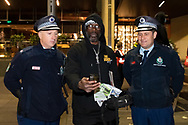 Rodney Overby former Sydney King Basketball player talks to two police officers in Martin Place on 02 June, 2020 in Sydney, Australia. This event was organised to rally against aboriginal deaths in custody in Australia as well as in unity with protests across the United States following the killing of an unarmed black man George Floyd at the hands of a police officer in Minneapolis, Minnesota. (Photo by Steven Markham/ Speed Media)
