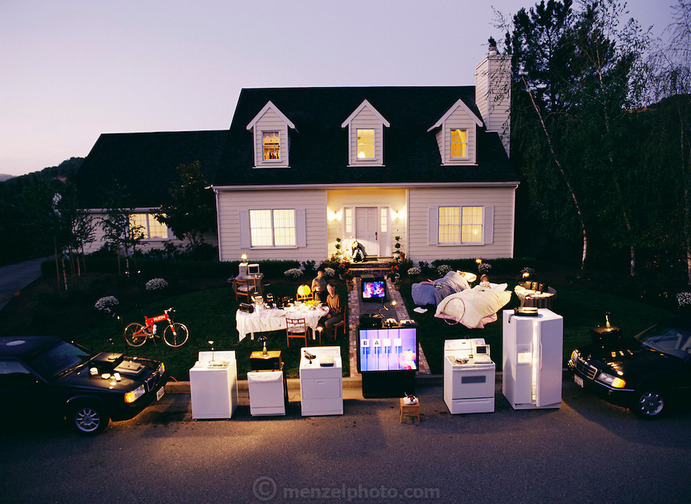 Portrait of a Northern California family with items having microprocessor chips, all in front of their home at dawn. From the One Digital Day Book.