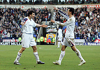 Photo: Paul Thomas.<br />Bolton Wanderers v Manchester City. The Barclays Premiership. 21/01/2006.<br />Bolton plaeyrs Tal Ben Haim (L) and Jared Borgetti celebrate Borgetti's goal.