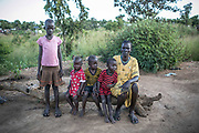 Nyagak Kok, 40, sits in the courtyard in front of her hut (not shown) in Bidibidi refugee settlement. On July 2016 after the second violence was erupted in Juba, she was met with six Dinka soldiers who carried AK-47. They threatened to kill her and four of them raped her while two guarded the scene. Her husband ran away in a different direction, but has been missing ever since. She now lives with her four children in Bidibidi camp worrying about how to survive.