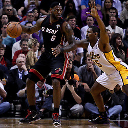 March 10, 2011; Miami, FL, USA; Miami Heat small forward LeBron James (6) is guarded by Los Angeles Lakers small forward Ron Artest (15) during the first quarter at the American Airlines Arena.  Mandatory Credit: Derick E. Hingle