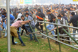 Protestors destroy barricade during a demonstration at the India Gate in New Delhi, India, December 23, 2012. Photo by Imago / i-Images...UK ONLY