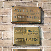 Brass name plate outside dental surgery, Ipswich, Suffolk, England