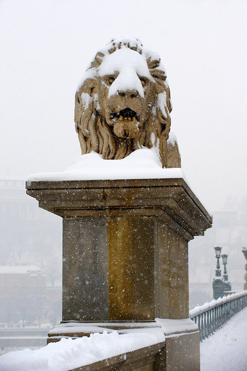 Szechenyi Lanchid (Chain Bridge) in the winter snow. Budapest Hungary stock photos .<br /> <br /> Visit our HUNGARY HISTORIC PLACES PHOTO COLLECTIONS for more photos to download or buy as wall art prints https://funkystock.photoshelter.com/gallery-collection/Pictures-Images-of-Hungary-Photos-of-Hungarian-Historic-Landmark-Sites/C0000Te8AnPgxjRg
