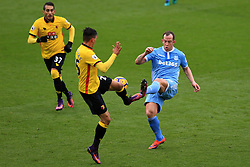 27 November 2016 - Premier League - Watford v Stoke City - Charlie Adam of Stoke City in action with Jose Holebas of Watford - Photo: Marc Atkins / Offside.