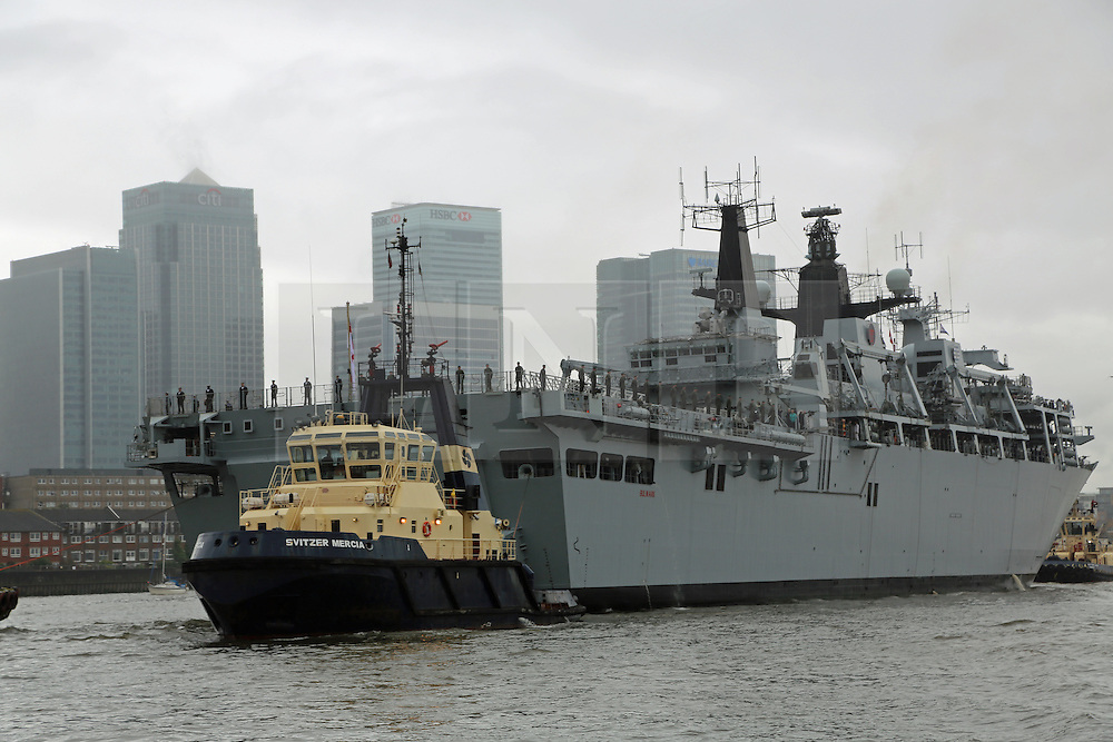 © Licensed to London News Pictures. 28/05/2014. HMS Bulwark has arrived in London for a visit which will help mark the 350th anniversary of the Royal Marines. The first sealord will be attending an event on board the ship to award the prize for the prestigious Pereguine photography competition. The flagship of the Royal Navy passed through the Thames Barrier on a rainy Wednesday before mooring at Greenwich in south east London next to the Old Royal Naval College. Credit : Rob Powell/LNP