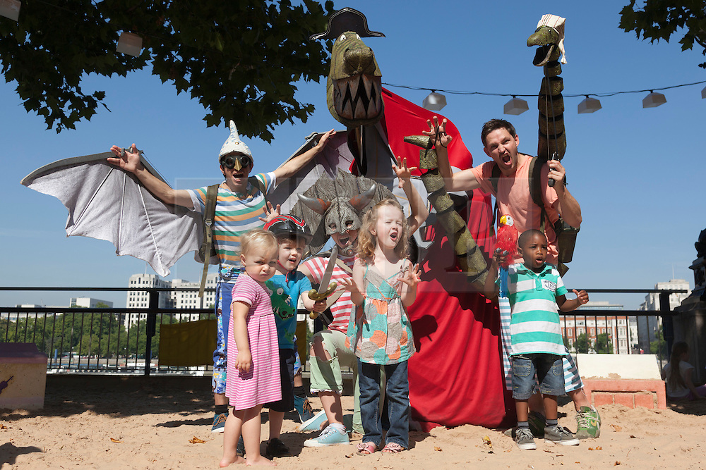 © Licensed to London News Pictures. 28 August 2013. London, England. Pictured: local children join into a photocall on the Southbank. The pirate dinosaur crew from Captain Flinn and the Pirate Dinosaurs arrive on  the Southbank from the Edinburgh Festival for performances at the London Wonderground from 28 August to 8 September 2013. The crew of this children's theatre show is captained by Mr T, a 10 foot Pirate Captain Tyrannous Rex. Photo credit: Bettina Strenske/LNP