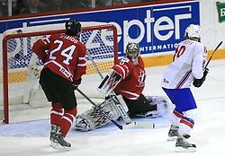 Steve Staios, Goalkeeper Cam Ward of Canada and Per-Age Skroder  (goal) of Norway at play-off round quarterfinals ice-hockey game Norway vs Canada at IIHF WC 2008 in Halifax,  on May 14, 2008 in Metro Center, Halifax, Nova Scotia,Canada. (Photo by Vid Ponikvar / Sportal Images)