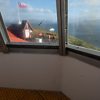 Tourists from Chilean cruise ship Mare Austraulis visit chapel and lighthouse at Cape Horn, Tierra del Fuego, Chile, southernmost tip of South America.