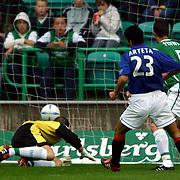 Hibernian's goalkeeper Nick Colgan watches the ball enter the net for the first goal scored by Rangers Ronald de Boer