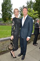 EVA HERZIGOVA and GREGORIO MARSIAJ at an Evening at The River Cafe in aid of the NSPCC held at The River Cafe, Thames Wharf, Rainville Road, London on 19th June 2016