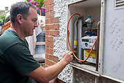 An air source heat pump installer from Solaris Energy checking the gas system for any drop in pressure before the old gas boiler is disconnected to be replaced by an air source heat pump at a property in Folkestone, United Kingdom on the 20th of September 2021. With gas prices increasing and the increasing need to reduce fossil fuel air source heat pumps are slowly starting to replace the gas boiler use in properties in the UK.