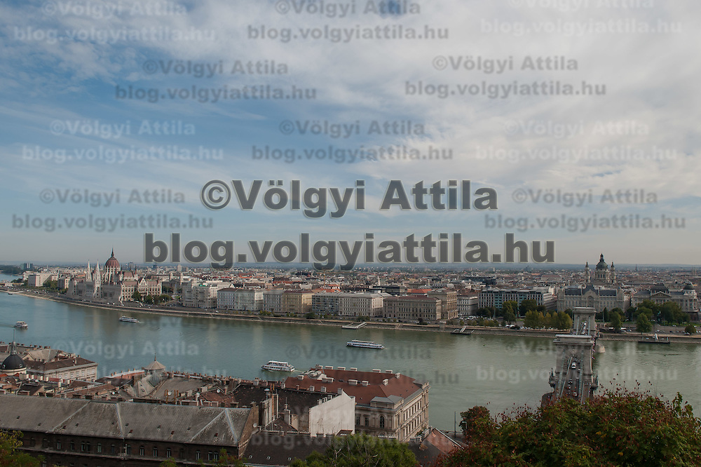 House of the Hungarian Parliament (L) and the cityscape on the Pest side of river Danube part of the world heritage located in Budapest, Hungary on September 29, 2011. ATTILA VOLGYI