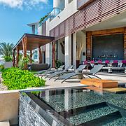 Casa Roberto De La Peña. Puerto Cancun. Photo by: Victor Elias Photography.