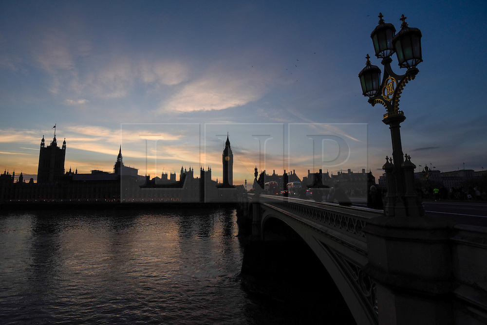 © Licensed to London News Pictures. 24/02/2017. London, UK. The sun sets behind the Houses of Parliament as seen from Westminster Bridge. Photo credit : Stephen Chung/LNP