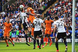 David Wheater of Bolton Wanderers clears from a corner under pressure from Benik Afobe of Wolverhampton Wanderers - Mandatory by-line: Matt McNulty/JMP - 21/04/2018 - FOOTBALL - Macron Stadium - Bolton, England - Bolton Wanderers v Wolverhampton Wanderers - Sky Bet Championship