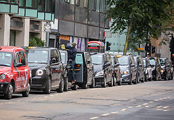 © Licensed to London News Pictures. 13/11/2020. London, UK. Taxis wait for fares at a rank in Westminster, London as the economic fallout of the second Covid-19 lockdown continues to hit jobs. Dominic Cummings, Boris Johnson's chief adviser, announced this morning that he will quit by Christmas after Lee Cain, No10's Director of Communications quit yesterday. Photo credit: Alex Lentati/LNP