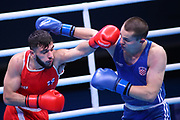 Muhammad Abdilrasoon of Finland (red) and Mladen Sobjeslavski of Croatia (bue) competing in the Men's Middleweight preliminaries during The Road to Tokyo European Olympic Boxing Qualification, Sunday, March 15, 2020, in London, United Kingdom. (Mitchell Gunn-ESPA-Images/Image of Sport)