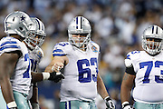 Dallas Cowboys center Ryan Cook (63) bumps fist with Dallas Cowboys tackle Tyron Smith (77) in between plays against the Pittsburgh Steelers at Cowboys Stadium in Arlington, Texas, on December 16, 2012.  (Stan Olszewski/The Dallas Morning News)