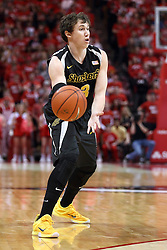 14 February 2015:   Evan Wessel passes the ball in past the 3 point line during an NCAA MVC (Missouri Valley Conference) men's basketball game between the Wichita State Shockers and the Illinois State Redbirds at Redbird Arena in Normal Illinois