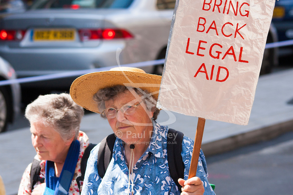 London, June 21st 2014. Two elderly ladies protest against cuts to legal aid budgets as thousands march against austerity in London.
