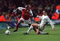 Sylvian Wiltord (Arsenal) Ian Harte (Leeds United). Leeds United v Arsenal, F.A.Carling Premiership, 26/11/2000. Credit Colorsport / Stuart MacFarlane