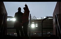 A steward directs a fan to his seat before the Emirates FA Cup, fourth round match at St Mary's Stadium, Southampton.