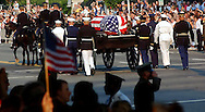 The casket of former President Ronald Reagan moves past mourners on Pennsylvania Ave en route to the Capital Rotunda for public viewing. The procession is apart of the week long state funeral for the 40th President of the United States.