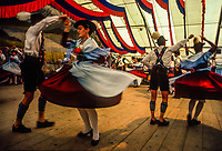 Bavarian couples in traditional costume dancing at the Beer festival, Garmisch-Partenkirchen, Germany.